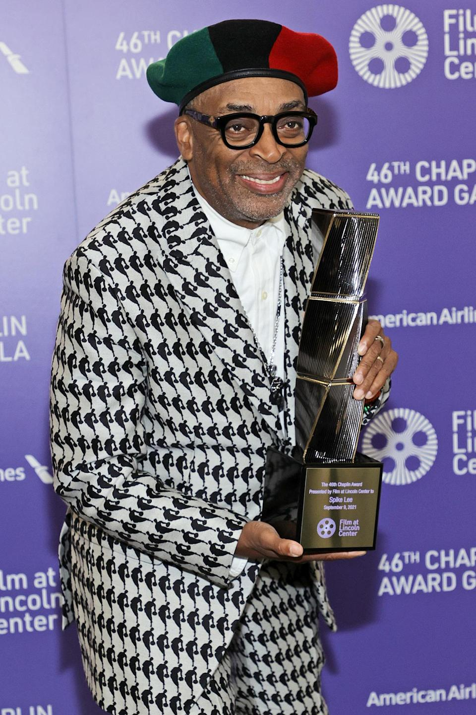 <p>Spike Lee holds up his award at the 46th Chaplin Award Gala honoring his career and legacy on Sept. 9 in N.Y.C. </p>