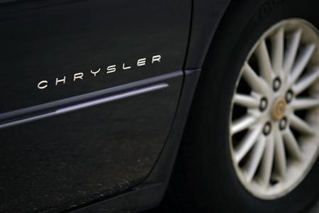 A Chrysler logo is seen on a car at a Chrysler car dealership in Toronto