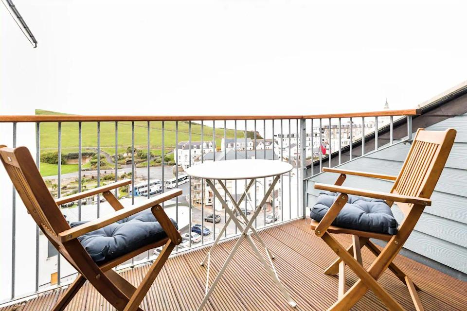 "<p>Just a stroll from Ilfracombe's galleries, Michelin-starred dining and coffee shops, this Airbnb in Devon is one for taking in the views from the balcony. The penthouse was once an old Victoria shop and has been renovated to provide a homely pad that's bright and modern.</p><p>There are harbour views from the dining room too and little luxurious include the rain shower, king-sized bed and breakfast bar. <strong><br></strong></p><p><strong>Sleeps</strong>: 2</p><p><strong>Price per night:</strong> £110</p><p><strong>Why we love it: </strong>The cosy yet modern feel that makes it a lovely spot for couples to spend a weekend by the sea. </p><p><a class=""link rapid-noclick-resp"" href=""https://go.redirectingat.com?id=127X1599956&url=https%3A%2F%2Fwww.airbnb.co.uk%2Frooms%2Fplus%2F26351687&sref=https%3A%2F%2Fwww.countryliving.com%2Fuk%2Ftravel-ideas%2Fstaycation-uk%2Fg32930188%2Fairbnb-cornwall-devon%2F"" rel=""nofollow noopener"" target=""_blank"" data-ylk=""slk:SEE INSIDE"">SEE INSIDE</a><br></p>"