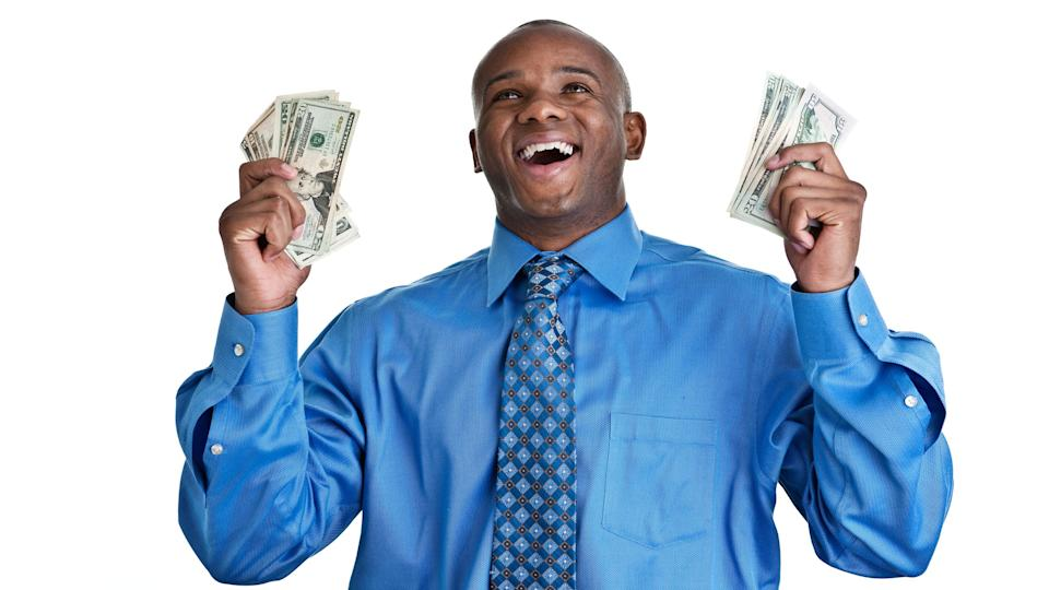 picture of smiling man holding money in both hands
