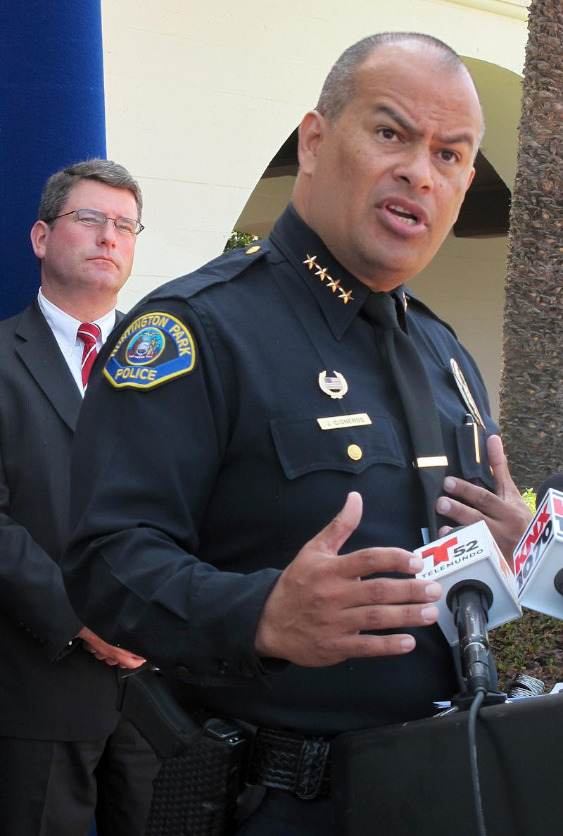 "Huntington Park Police Chief Jorge Cisneros, right, with FBI Los Angeles Tim Delaney, left, speaks during a news conference into the investigation of a Sept 2012 bank robbery in in Huntington Park, Calif., on Monday, May 20,  2013. A man has been charged with a Los Angeles-area bank robbery in which his girlfriend — an assistant bank manager — reported being kidnapped and forced to wear what she thought was a bomb strapped to her midsection. Authorities said Monday that Reyes ""Ray"" Vega and two others were charged with bank robbery and other felony counts. (AP Photo/Nick Ut)"