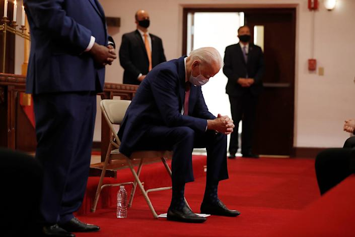 Democratic presidential candidate, former Vice President Joe Biden bows his head in prayer as he visits Bethel AME Church in Wilmington, Del., Monday, June 1, 2020. (AP Photo/Andrew Harnik)