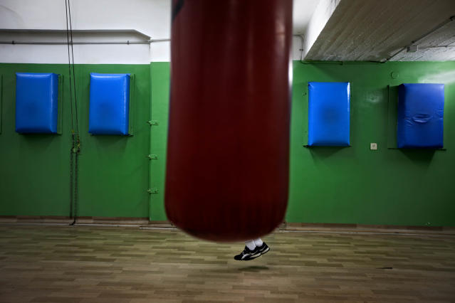 <p>A young Israeli boxer jumps rope ahead of the Israel's National Youth Boxing Championship at a boxing club in the southern Israeli town of Sderot on Feb. 28, 2012. (Photo: Oded Balilty/AP) </p>