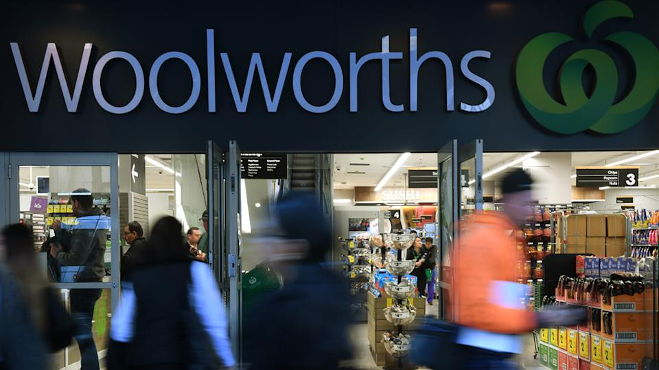 Photo shows people walking past a busy Woolworths store. Source: AAP