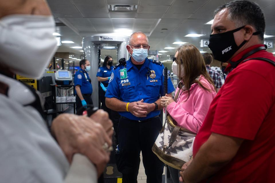 TSA supervisor and passenger support specialist Jeffrey Cote (center) talks with Kelly Campbell (second from left, of Foundation for Blind Children) during a TSA Cares tour on Sept. 14, 2021, in Terminal 4 at Phoenix Sky Harbor International Airport.