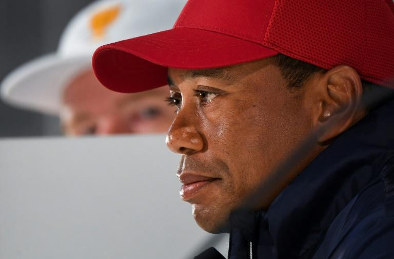 Captain of the US team Tiger Woods speaks during a press conference in Melbourne as International Team captain Ernie Els listens ahead of the Presidents Cup