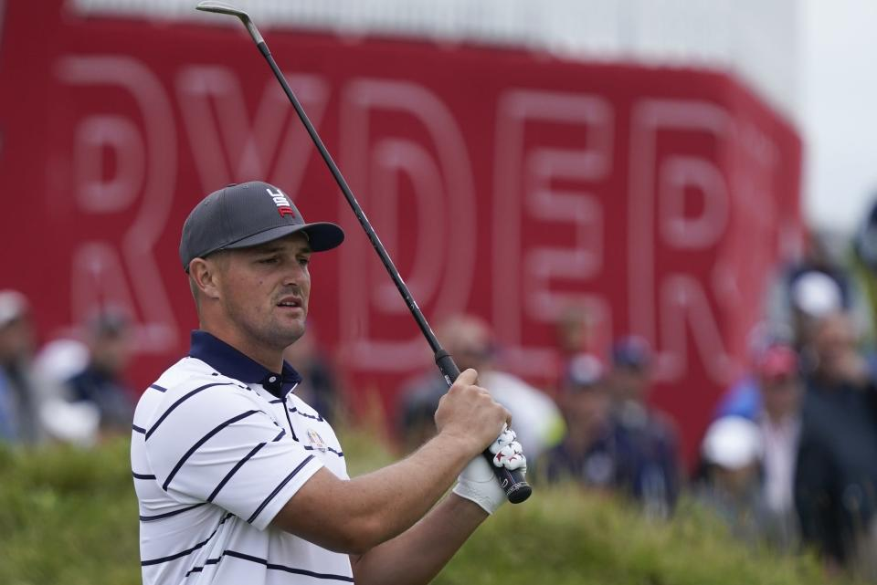 Team USA's Bryson DeChambeau hits a shot on the first hole during a practice day at the Ryder Cup at the Whistling Straits Golf Course Tuesday, Sept. 21, 2021, in Sheboygan, Wis. (AP Photo/Charlie Neibergall)
