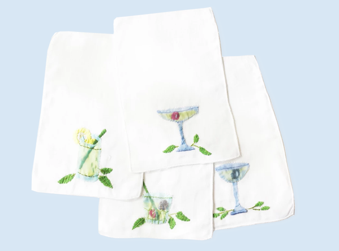 """<p>We think olive-adorned cocktail napkins pair especially well with holiday martinis. And this happy-hour-minded friend is bound to concur.</p> <p><a href=""""https://www.biscuit-home.com/collections/linens/products/applique-cocktail-napkins"""" target=""""_blank""""><em>Biscuit Home</em></a><em> ($68)</em></p>"""