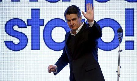 Milanovic, leader of the Social Democratic Party (SDP), waves to supporters after a parliamentary election in Zagreb