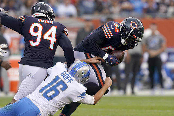 Detroit Lions quarterback Jared Goff (16) tries to tackle Chicago Bears outside linebacker Khalil Mack after Mack's fumble recovery during the first half of an NFL football game Sunday, Oct. 3, 2021, in Chicago. (AP Photo/Nam Y. Huh)