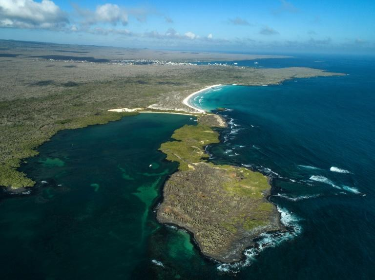 An aerial view of the Tortuga Bay area in Santa Cruz Island, Galapagos, Ecuador -- a popular tourist destination, but one which cannot handle all of the people who want to come if it wants to preserve its rich ecosystems