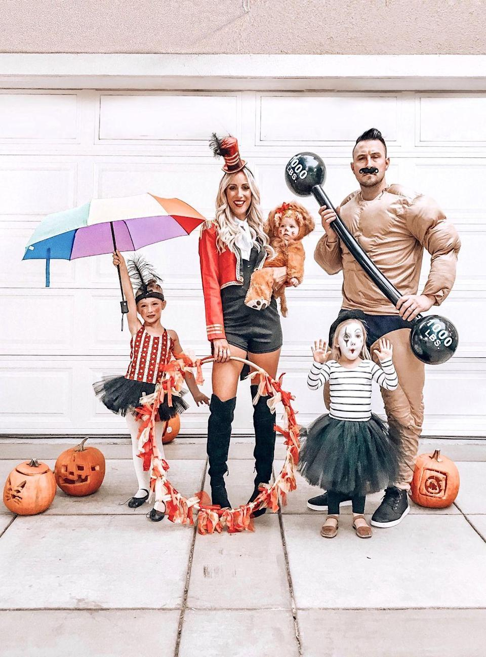 """<p>Go all out and make your circus-inspired costume a family affair. Everyone can suit up and join the show! </p><p><strong>See more at <a href=""""https://www.instagram.com/p/BppWHS7B3Qn/"""" rel=""""nofollow noopener"""" target=""""_blank"""" data-ylk=""""slk:@sarah_lit"""" class=""""link rapid-noclick-resp"""">@sarah_lit</a>. </strong></p><p><a class=""""link rapid-noclick-resp"""" href=""""https://www.amazon.com/Rain-Mate-Compact-Travel-Umbrella-Reinforced/dp/B071JR3HFX/ref=sr_1_2?tag=syn-yahoo-20&ascsubtag=%5Bartid%7C10050.g.29402076%5Bsrc%7Cyahoo-us"""" rel=""""nofollow noopener"""" target=""""_blank"""" data-ylk=""""slk:SHOP UMBRELLAS"""">SHOP UMBRELLAS</a></p>"""