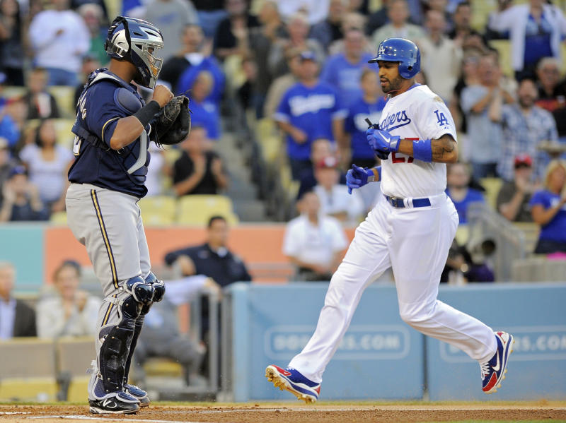 Los Angeles Dodgers' Matt Kemp, right, scores on a double by Andre Ethier as Milwaukee Brewers catcher Martin Maldonado looks on during the first inning of their baseball game, Wednesday, May 30, 2012, in Los Angeles. (AP Photo/Mark J. Terrill)