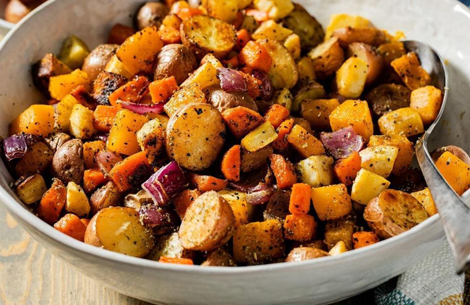 """<p>Nothing screams Thanksgiving and fall quite like roasted harvest vegetables. This hearty recipe is a combination of colorful veggies like red potatoes, carrots and red onions. But don't open the oven to see whether your potatoes have turned golden brown too early — not being patient is one <a href=""""https://www.thedailymeal.com/cook/bad-cooking-habits?referrer=yahoo&category=beauty_food&include_utm=1&utm_medium=referral&utm_source=yahoo&utm_campaign=feed"""" rel=""""nofollow noopener"""" target=""""_blank"""" data-ylk=""""slk:bad cooking habit you need to stop"""" class=""""link rapid-noclick-resp"""">bad cooking habit you need to stop</a>.</p> <p><a href=""""https://www.thedailymeal.com/recipe/roasted-harvest-vegetable?referrer=yahoo&category=beauty_food&include_utm=1&utm_medium=referral&utm_source=yahoo&utm_campaign=feed"""" rel=""""nofollow noopener"""" target=""""_blank"""" data-ylk=""""slk:For the Roasted Harvest Vegetables recipe, click here."""" class=""""link rapid-noclick-resp"""">For the Roasted Harvest Vegetables recipe, click here.</a></p>"""