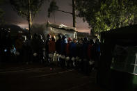 Migrants queue up to receive food in Las Raices camp in San Cristobal de la Laguna, in the Canary Island of Tenerife, Spain, Wednesday, March 17, 2021. Several thousand migrants have arrived on the Spanish archipelago in the first months of 2021. Due to the terrible living conditions and the poor quality of food and water at the Las Raices camp, some migrants have decided to leave the camp and sleep in shacks in a nearby forest instead. (AP Photo/Joan Mateu)