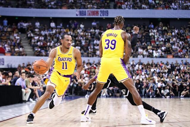 """Lakers guard Avery Bradley (11) drives around a screen set by teammate Dwight Howard during a preseason game in October. <span class=""""copyright"""">(Getty Images)</span>"""