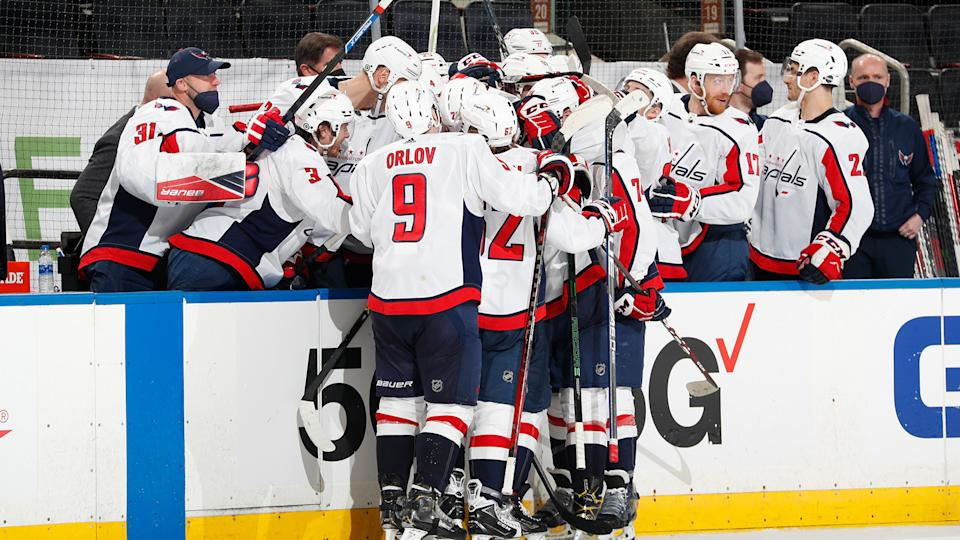 T.J. Oshie is mobbed by teammates after scoring his third goal of the game against the Rangers. (Photo by Jared Silber/NHLI via Getty Images)