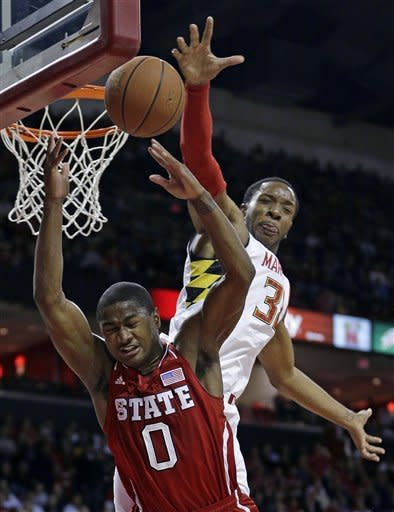 North Carolina State guard Rodney Purvis (0) collides with Maryland forward Dez Wells as he goes up for a shot in the first half of an NCAA college basketball game in College Park, Md., Wednesday, Jan. 16, 2013. (AP Photo/Patrick Semansky)
