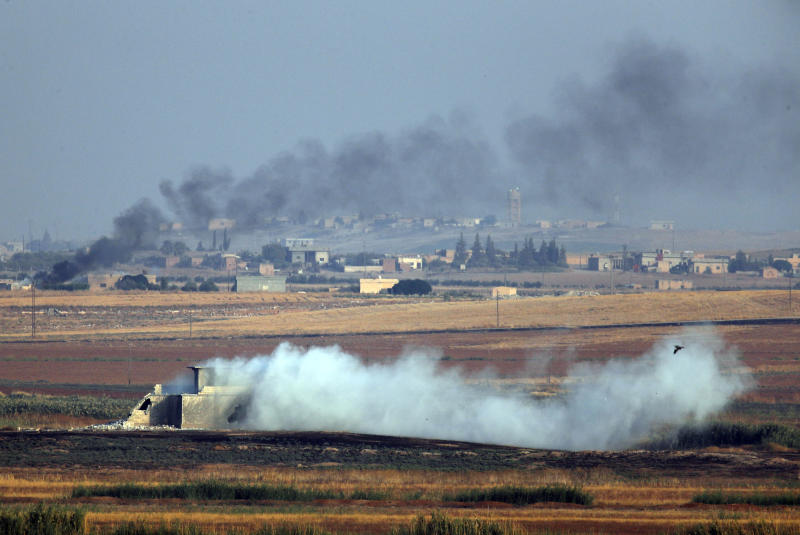 In this photo taken from the Turkish side of the border between Turkey and Syria, in Akcakale, Sanliurfa province, southeastern Turkey, smoke billows from targets inside Syria during bombardment by Turkish forces, Oct. 9, 2019. (Photo: Lefteris Pitarakis/AP)