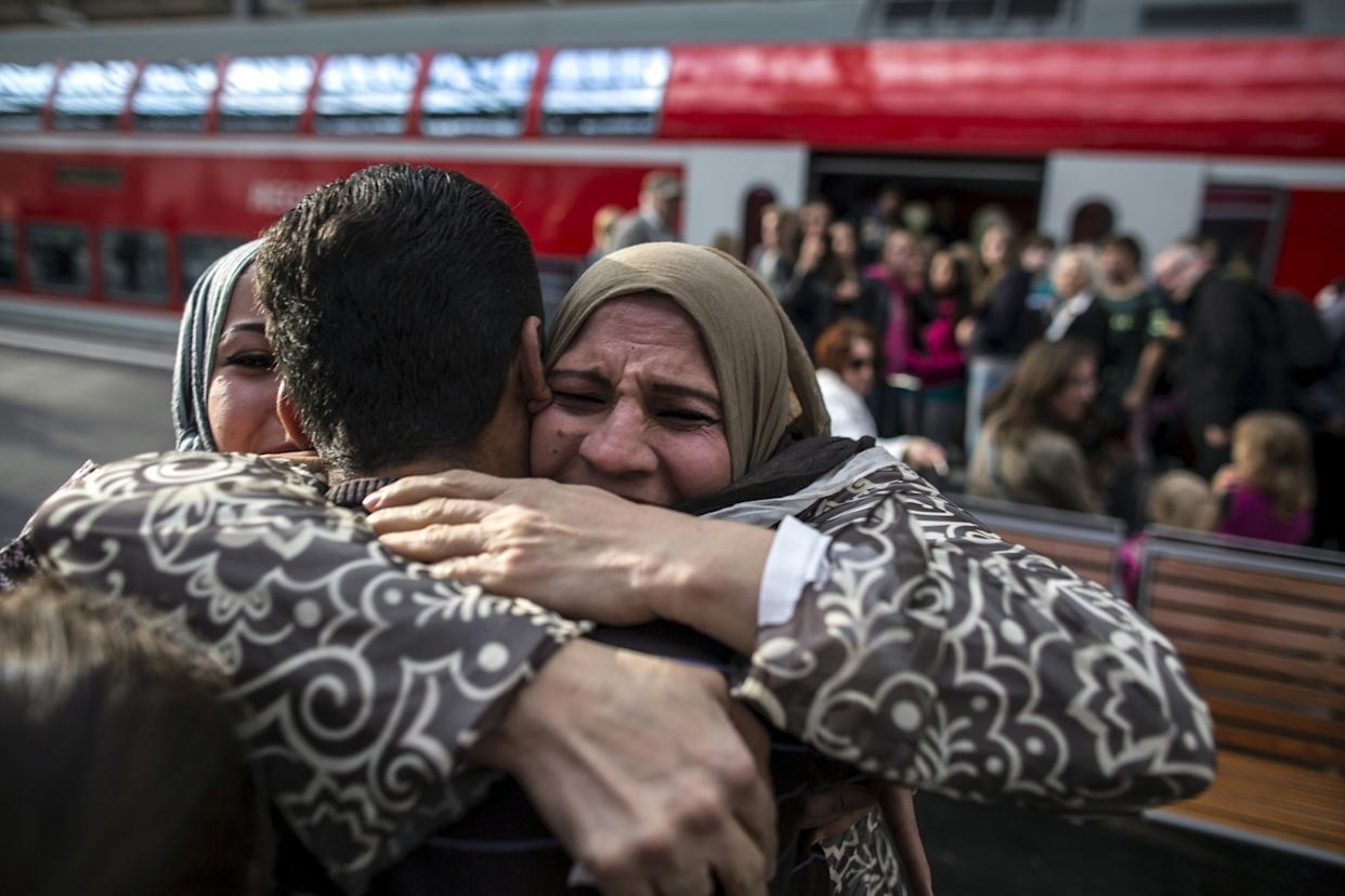Houda, 48, hugs her son Ihab, 30, a Syrian migrant from Deir al-Zor, as he and his family arrive at the railway station in Lubeck, Germany September 18, 2015. Picture taken September 18, 2015.