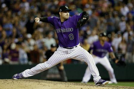FILE PHOTO: Aug 10, 2018; Denver, CO, USA; Colorado Rockies relief pitcher Adam Ottavino (0) pitches in the ninth inning against the Los Angeles Dodgers at Coors Field. Mandatory Credit: Isaiah J. Downing-USA TODAY Sports