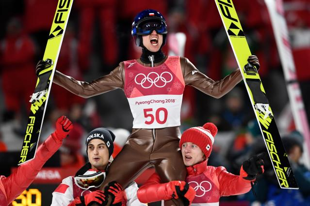 <p>Poland's Kamil Stoch celebrates winning the men's large hill individual ski jumping event during the Pyeongchang 2018 Winter Olympic Games on February 17, 2018, in Pyeongchang. / AFP PHOTO / Jonathan NACKSTRAND </p>
