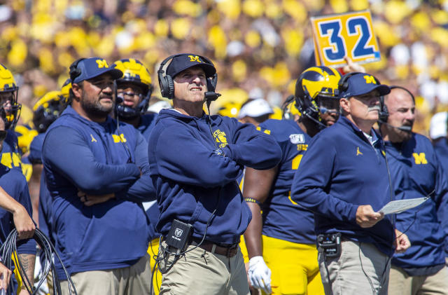 Michigan head coach Jim Harbaugh, center, reacts looking up at the scoreboard in the second quarter of an NCAA football game against Army in Ann Arbor, Mich., Saturday, Sept. 7, 2019. (AP Photo/Tony Ding)