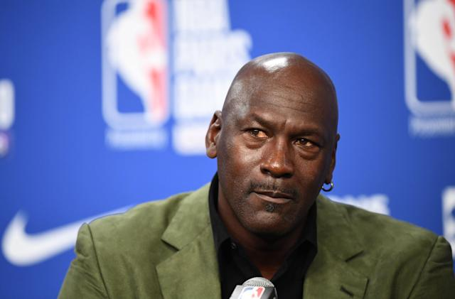 Former NBA star and owner of Charlotte Hornets team Michael Jordan looks on as he addresses a press conference ahead of the NBA basketball match between Milwaukee Bucks and Charlotte Hornets at The AccorHotels Arena in Paris on January 24, 2020. (Photo by FRANCK FIFE / AFP) (Photo by FRANCK FIFE/AFP via Getty Images)