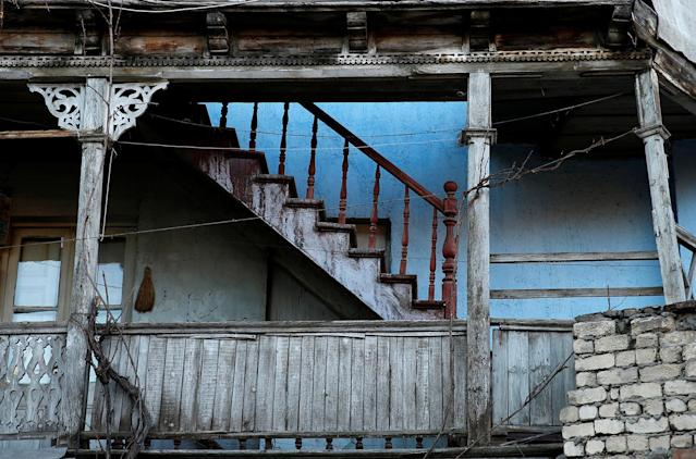 <p>Wooden stairs and a balcony are seen in a courtyard in the old town, Tbilisi, Georgia, April 4, 2017. (Photo: David Mdzinarishvili/Reuters) </p>
