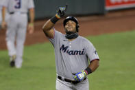Miami Marlins' Jesus Aguilar reacts after hitting a solo home run off Baltimore Orioles starting pitcher Tom Eshelman during the eighth inning of a baseball game, Tuesday, Aug. 4, 2020, in Baltimore. (AP Photo/Julio Cortez)