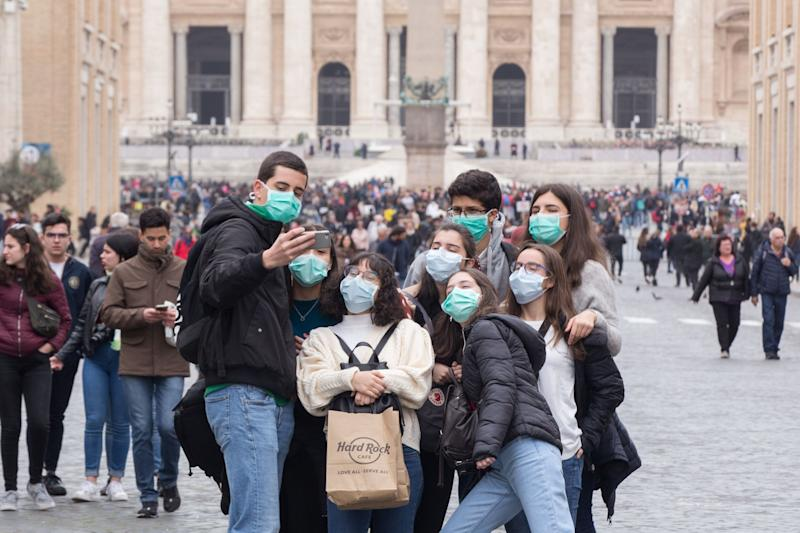 People wear face masks to protect themselves while visiting the Vatican on Ash Wednesday. (Photo: Pacific Press via Getty Images)