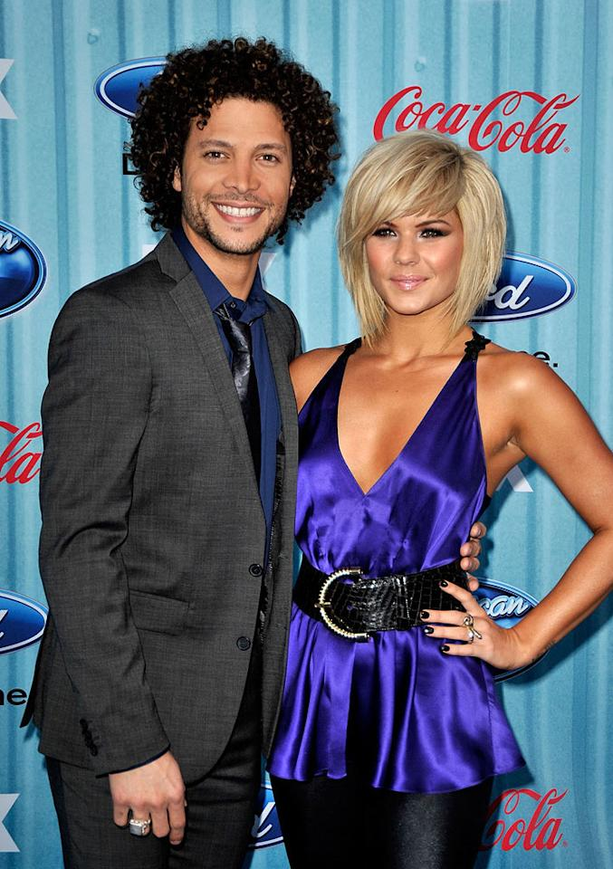 """TV Personalities <a href=""""/justin-guarini/contributor/1147136"""">Justin Guarini</a> and <a href=""""/kimberly-caldwell/contributor/1247717"""">Kimberly Caldwell</a> arrive at the <a href=""""/american-idol/show/34934"""">""""American Idol""""</a> Top 13 Party held at AREA nightclub on March 5, 2009 in Los Angeles, California."""