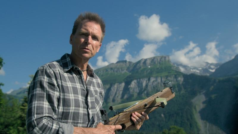 "This image released by CBS shows host Phil Keoghan in a scene from last season's competition series ""The Amazing Race.""  CBS said in a statement Friday, Feb. 28, 2020, that it had temporarily suspended production on the show's 33rd season as a precaution due to the virus outbreak affecting several countries. (CBS via AP)"