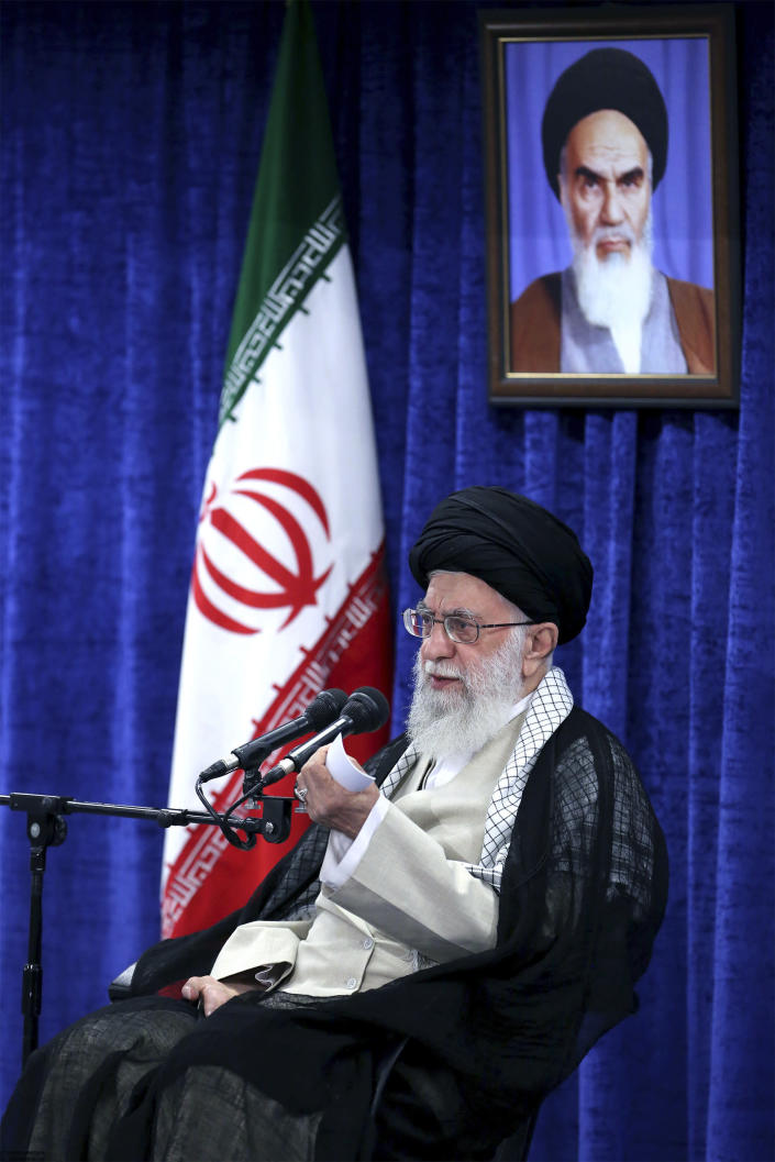 In this picture released by an official website of the office of the Iranian supreme leader, Supreme Leader Ayatollah Ali Khamenei speaks in a meeting with governmental officials in Tehran, Iran, Tuesday, May 14, 2019. Khamenei said his country won't negotiate with the United States and there will be no war between the two countries. A portrait of the late revolutionary founder Ayatollah Khomeini hangs at rear. (Office of the Iranian Supreme Leader via AP)