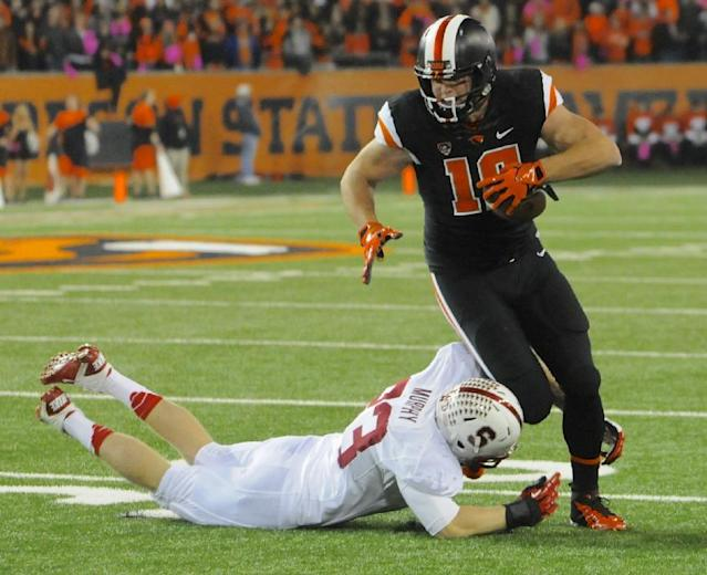 Oregon State's Caleb Smith (10) runs against Stanford's Trent Murphy (93) during the first half of an NCAA college football game in Corvallis, Ore., Saturday October 26, 2013. (AP Photo/Greg Wahl-Stephens)
