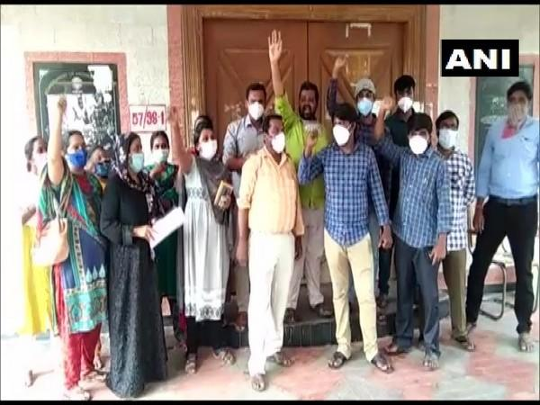Contract lab technicians protest outside the DMHO office in Kadapa district, Andhra Pradesh on Sunday. (Photo/ANI)
