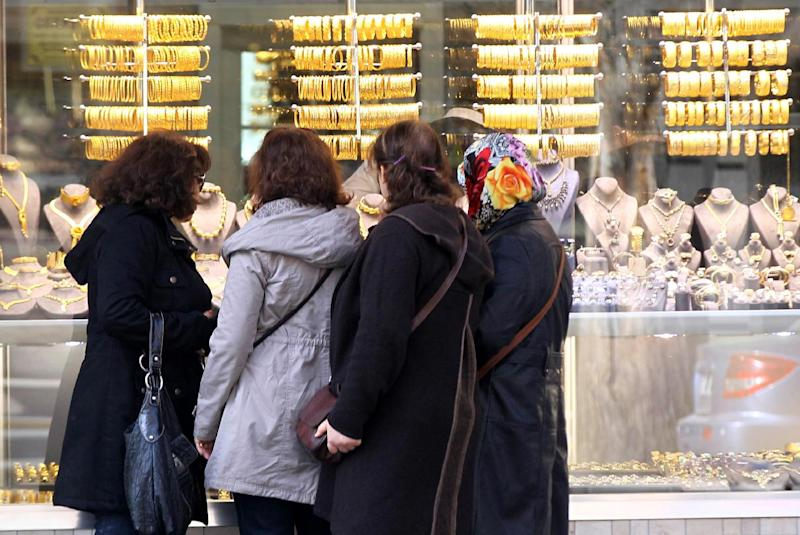 Women look in the window of a jewellery store in Ankara's Ulus district on February 19, 2014 (AFP Photo/Adem Altan)
