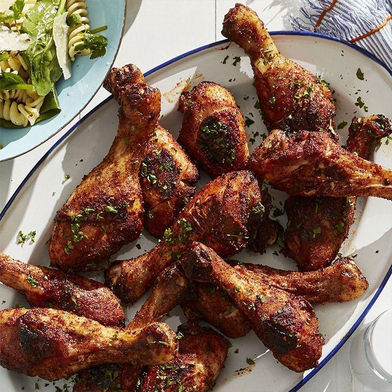 """<p>These seasoned drumsticks are the perfect blend of savory and sweet by combining brown sugar and chili powder. Great served cold or hot out of the pan.</p><p><em><a href=""""https://www.womansday.com/food-recipes/food-drinks/a27484243/cold-spiced-chicken-recipe/"""" rel=""""nofollow noopener"""" target=""""_blank"""" data-ylk=""""slk:Get the Cold Spiced Chicken recipe."""" class=""""link rapid-noclick-resp"""">Get the Cold Spiced Chicken recipe.</a></em></p>"""