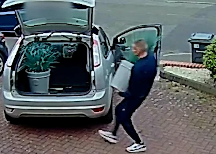 A man was caught on CCTV stealing three plants from a drive in Harborne, Birmingham (SWNS)