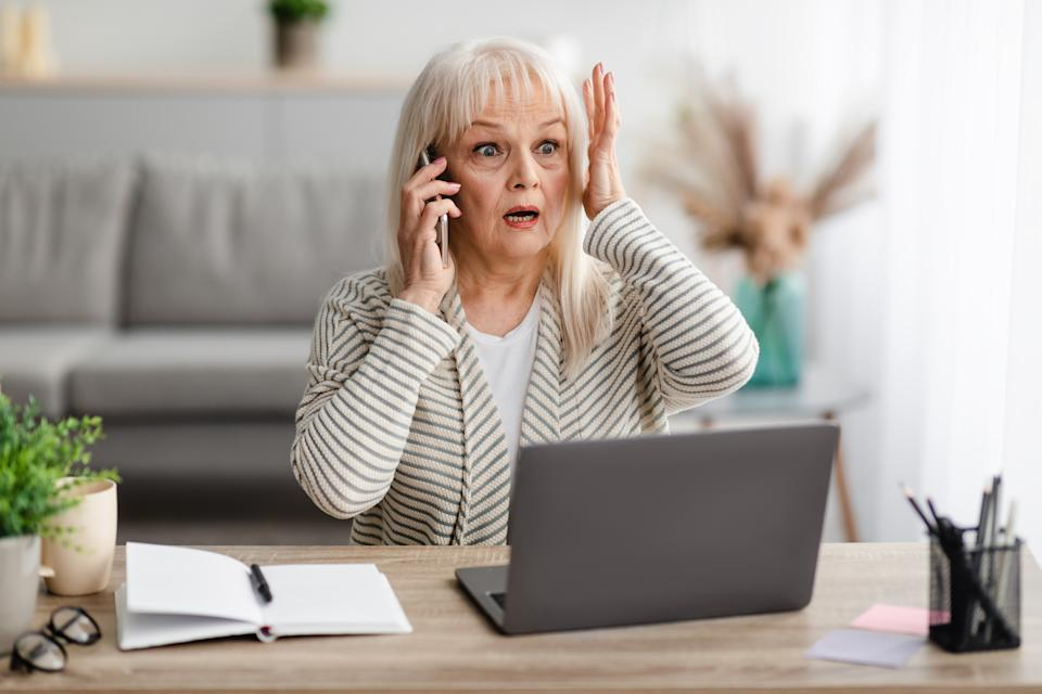 Shocked mature woman talking on smartphone. Source: Getty Images