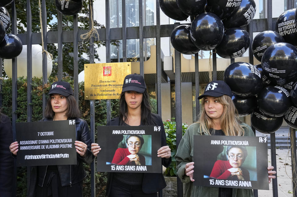 FILE - In this Oct. 6, 2021, file photo, members of Reporters Without Borders, stage a demonstration outside the Russian embassy in Paris, to pay tribute to late Russian journalist Anna Politkovskaya who was shot dead on Oct. 7, 2006 in Moscow. Anna Politkovskaya was a prominent journalist at the Novaya Gazeta newspaper who was famous for her critical coverage of the war in Chechnya. (AP Photo/Michel Euler, File)