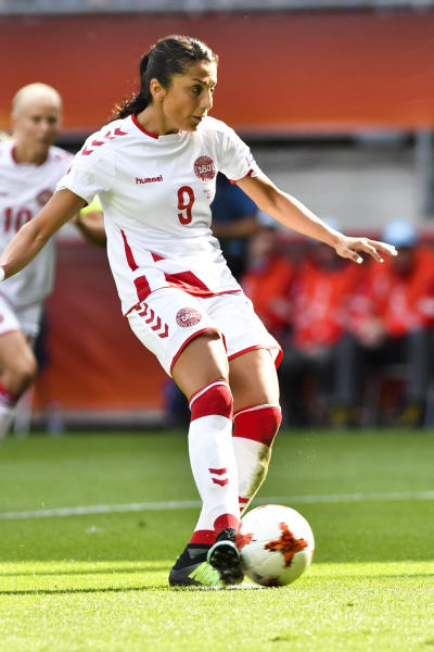FILE - In this file photo dated Sunday, Aug. 6, 2017, Denmark's Nadia Nadim kicks a penalty during the Women's Euro 2017 final soccer match against  Netherlands in Enschede, the Netherlands. Two decades after fleeing Afghanistan, the Paris Saint-Germain and Denmark striker Nadia Nadim is ready to go home, she tells The Associated Press Wednesday Dec. 4, 2019, that she will take a chance with her safety because the risks are worth it to inspire girls to follow her onto the soccer field. (AP Photo/Patrick Post, FILE)