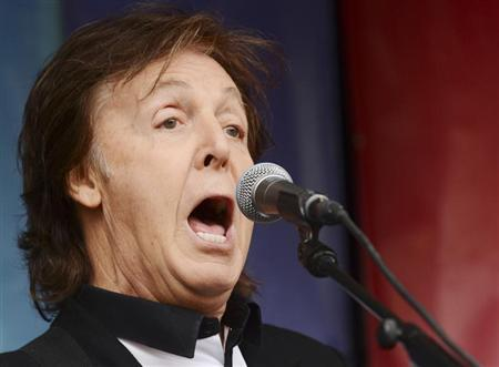 """Singer Paul McCartney performs during an impromptu concert to promote his album """"New"""" in London"""