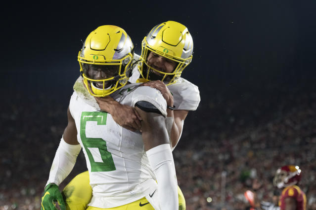 Oregon wide receiver Juwan Johnson, left, celebrates his touchdown with running back Travis Dye during the second half of an NCAA college football game against Southern California, Saturday, Nov. 2, 2019, in Los Angeles. (AP Photo/Kyusung Gong)