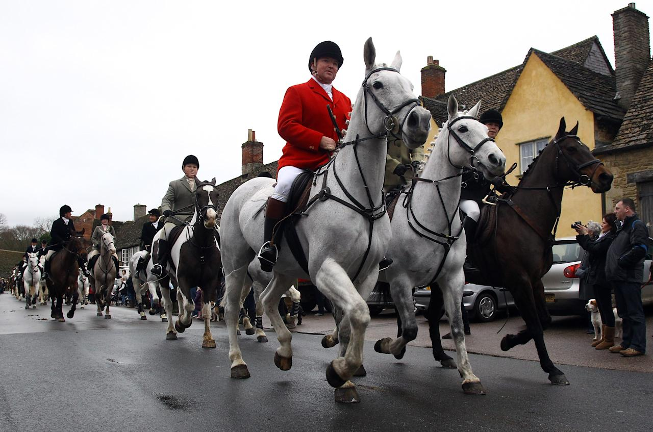 "LACOCK, UNITED KINGDOM - DECEMBER 26:  Riders with the Avon Vale Hunt ride out for their traditional Boxing Day hunt, on December 26, 2011 in Lacock, England. As hundreds of hunts gather today for their traditional Boxing Day meets Agriculture Minister Jim Paice has said the Hunting Act ""simply doesn't work"" and added that there should be a vote on whether to repeal the act when there was ""time in the parliamentary calendar"".  (Photo by Matt Cardy/Getty Images)"