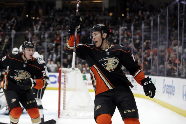 Anaheim Ducks' Carter Rowney, right, celebrates after scoring against the Los Angeles Kings during the second period of an NHL hockey game, Monday, Dec. 2, 2019, in Anaheim, Calif. (AP Photo/Marcio Jose Sanchez)