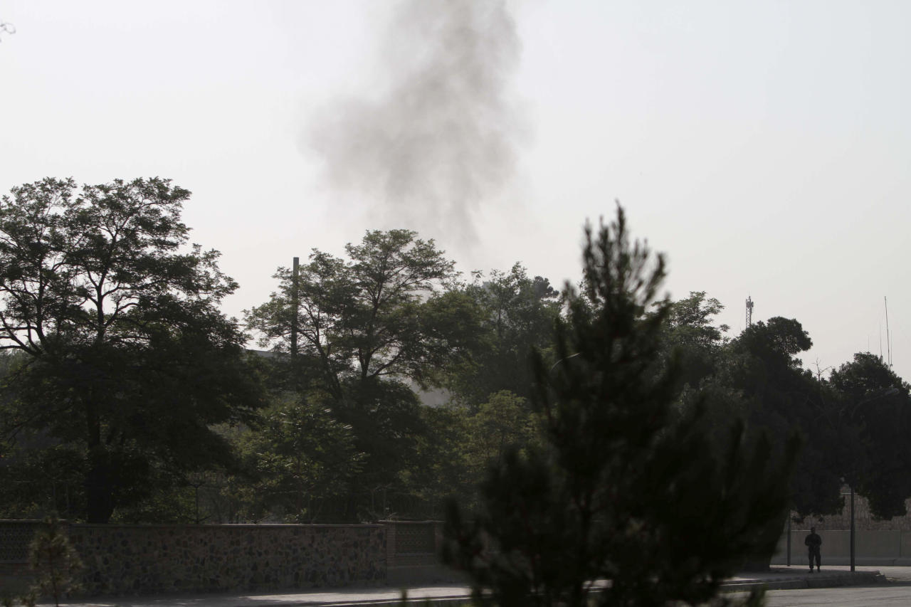 Smoke rises from the eastern gate of the presidential palace in Kabul, Afghanistan, Tuesday June 25, 2013. The Taliban said they have hit one of the most secure areas of the Afghan capital with a suicide attack, as a series of explosions rocked the gate leading into the presidential palace. (AP Photo/Rahmat Gul)