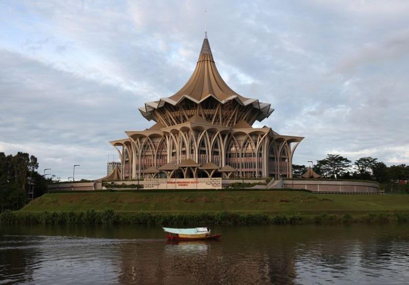 A boat passes by the Sarawak State Legislative Assembly in Kuching. — Reuters pic