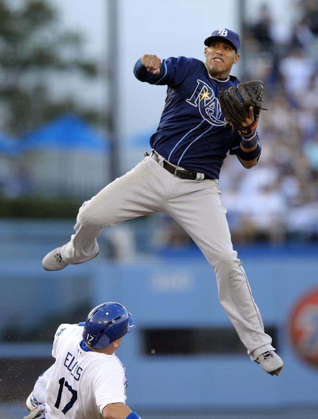 Los Angeles Dodgers' A.J. Ellis, below, is forced out at second as Tampa Bay Rays shortstop Yunel Escobar throws out Juan Uribe at first during the fifth inning of their baseball game, Sunday, Aug. 11, 2013, in Los Angeles. (AP Photo/Mark J. Terrill)