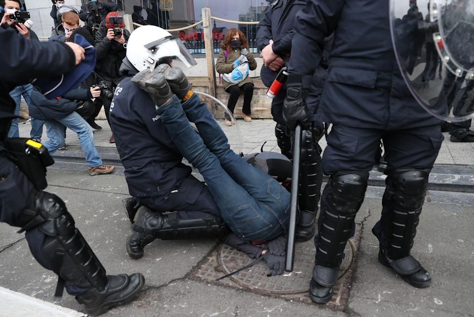 BRUSSELS, BELGIUM - JANUARY 31: Police officers intervene in protesters as they gather to stage a protest against government-imposed measures to tackle the coronavirus (Covid-19) pandemic, at Albertine Square in Brussels, Belgium, on January 31, 2021. (Photo by Dursun Aydemir/Anadolu Agency via Getty Images) (Photo: Anadolu Agency via Getty Images)
